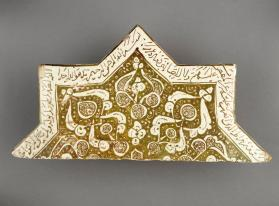 Lustre-ware tile with arabesques and Qur'anic inscription