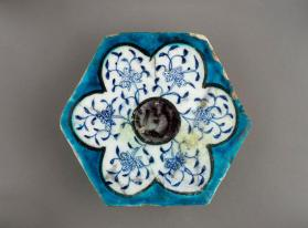 Hexagonal tile with lotus flowers