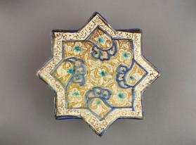 Tile in star form with lustre-painted arabesque design