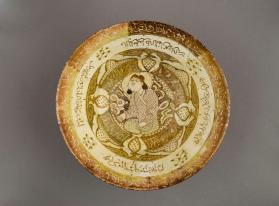 Lustre-ware bowl with seated figure and Persian poetry