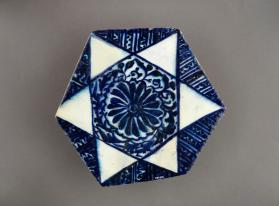 Hexagonal tile with star and lotus