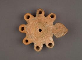 Oil lamp with seven wick-holes