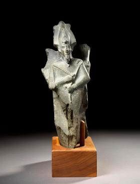 Statue of man offering an image of Osiris