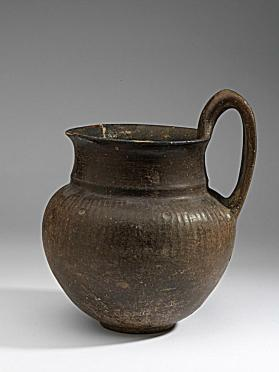 Polished brown ware jug