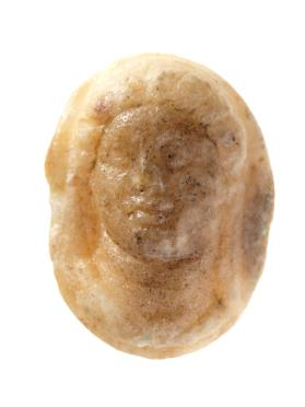 Finger ring with woman's head in high relief, three-quarters view