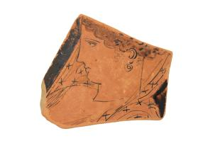 Red-figure vase fragment with a woman's head