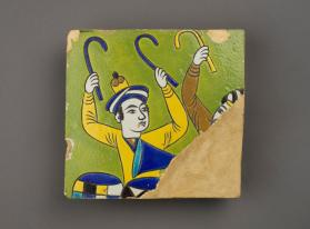Tile from arch frieze of drummers and trumpeters