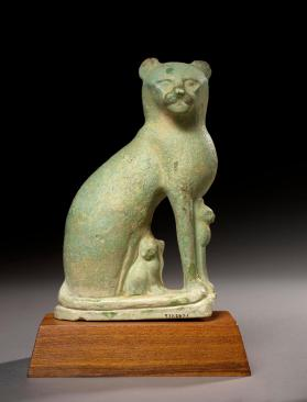 Figure of a seated cat with kittens