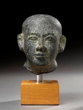 Figure, head of a priest