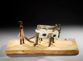 Tomb model of man ploughing