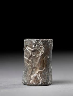 Cylinder seal of Shu-ili-su, the brewer, with contest scene, fighting a lion