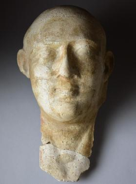 Mummy mask of a male, possibly a priest with shaved head