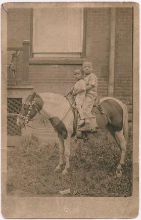 Norman H. Lee (Diddy) and Frank Newton Lee Jr. (Newtie), on a pony near St. Patrick Street