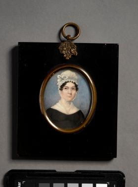 Portrait miniature of a woman in black frame