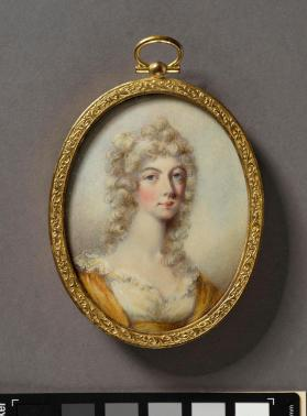 Portrait miniature of woman in white and yellow dress