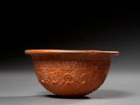 Megarian bowl with Athena Parthenos medallion and wave spiral motif