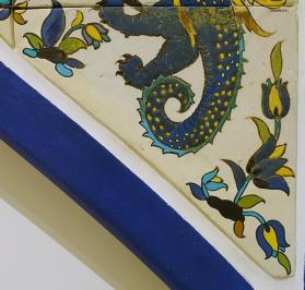 Tile from arch frieze of dragon-slaying scene