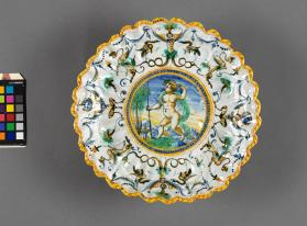 Moulded dish (crespina) (coupe godronnée) with a depiction of a 'Putto Hunting'