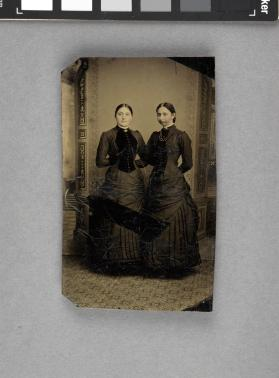 [Two women, standing]