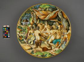 Large dish (piatto) with a depiction of a Mythological Scene 'Mankind Feasting Before the Flood' after an engraving by Johannes Sadeler I (1550-1600) after a (lost) painting of about 1580 by Dirck Barendsz. (1534–1592)