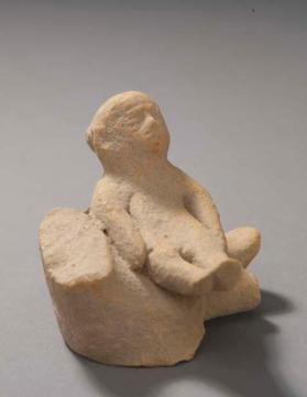 Fragmentary figure of a mother with an infant on her lap
