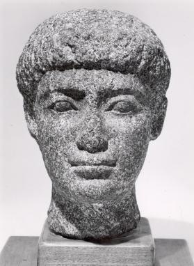 Head of a fragmentary male figure with short hair