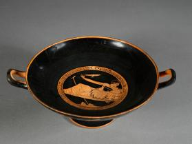 Attic red-figure kylix with a symposiast and a boxing scene