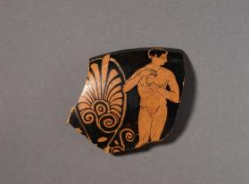 Attic red-figure cup fragment showing a youth using a strigil