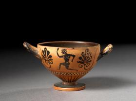 Attic black-figure skyphos cup showing men running