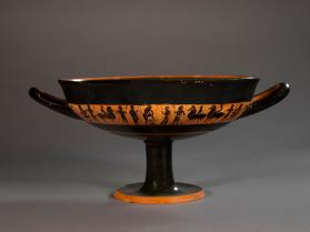 Attic black-figure cup showing warriors arming