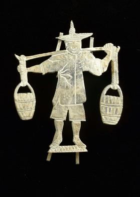 Silver placecard holder in the shape of a Chinese worker