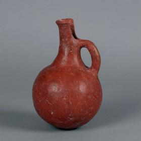 Jug of Red Polished III ware with cut-away spout