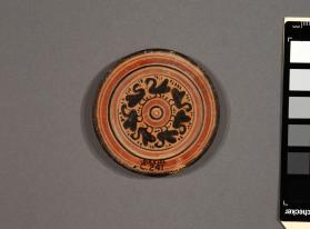 Attic black-figure miniature plate decorated with swans