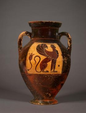 Black-figure amphora showing a sphinx and a bull