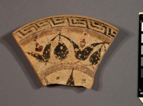 Rim fragment of an East Greek dish with a lotus-and-bud pattern