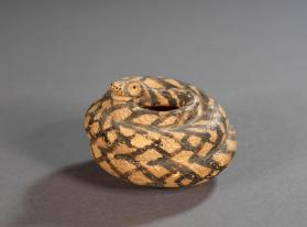 East Greek 'plastic vase' in the form of a coiled snake