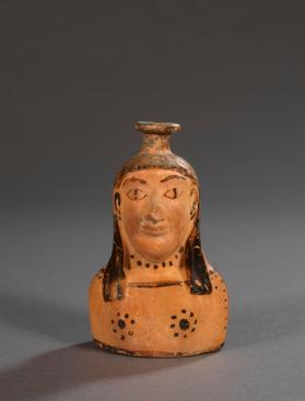 East Greek 'plastic vase' (perfume jar) in the shape of a woman