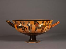 Attic black-figure cup showing a frieze of horseriders with attendants