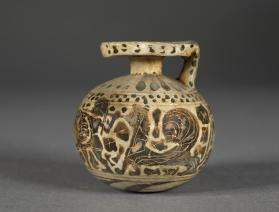Corinthian black-figure aryballos with duelling warriors, a horseman and a sphinx