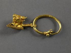 Hoop earring with bull's head pendant
