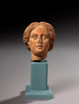 Female figure head fragment