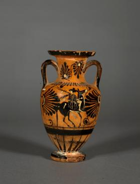 Attic black-figure amphora showing a Maenad riding a mule