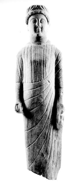 Figure of a draped male votary holding an offering
