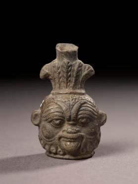 """Plastic"" vase, head of the god Bes"