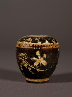 Black-gloss lidded-pyxis with wave and vine motifs in added paint