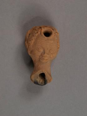 Ptolemaic 'plastic' oil lamp in the shape of a head