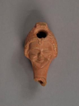Ptolemaic oil lamp in the form of a girl's head