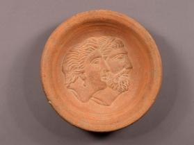 Votive dish with jugate heads of a woman and man