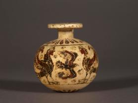 Corinthian black-figure aryballos with a goat, two sirens and birds