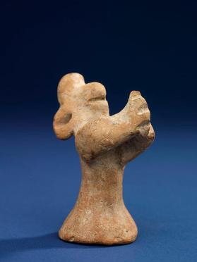 Figure with hands clasped together